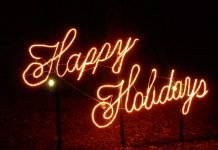 light up neon saying happy holidays