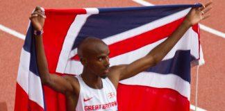 Mo Farah celebrating holding Union Flag