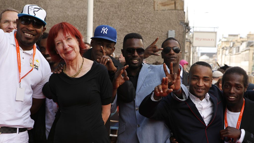 A group picture of the artist with the crew of her film