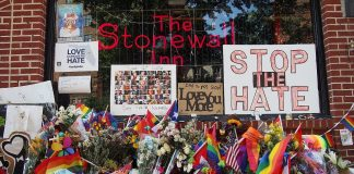 Image from outside Stonewall Inn of pride flags