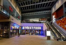 View inside Westgate Shopping Centre showing Westgate Streetfood, with escalators on the right side