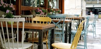 Colourful chairs and tables on the street outside a restaurant