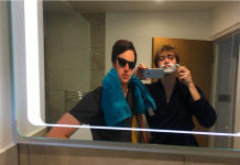 Photo of two friends shaving, one is a cardboard cut-out.