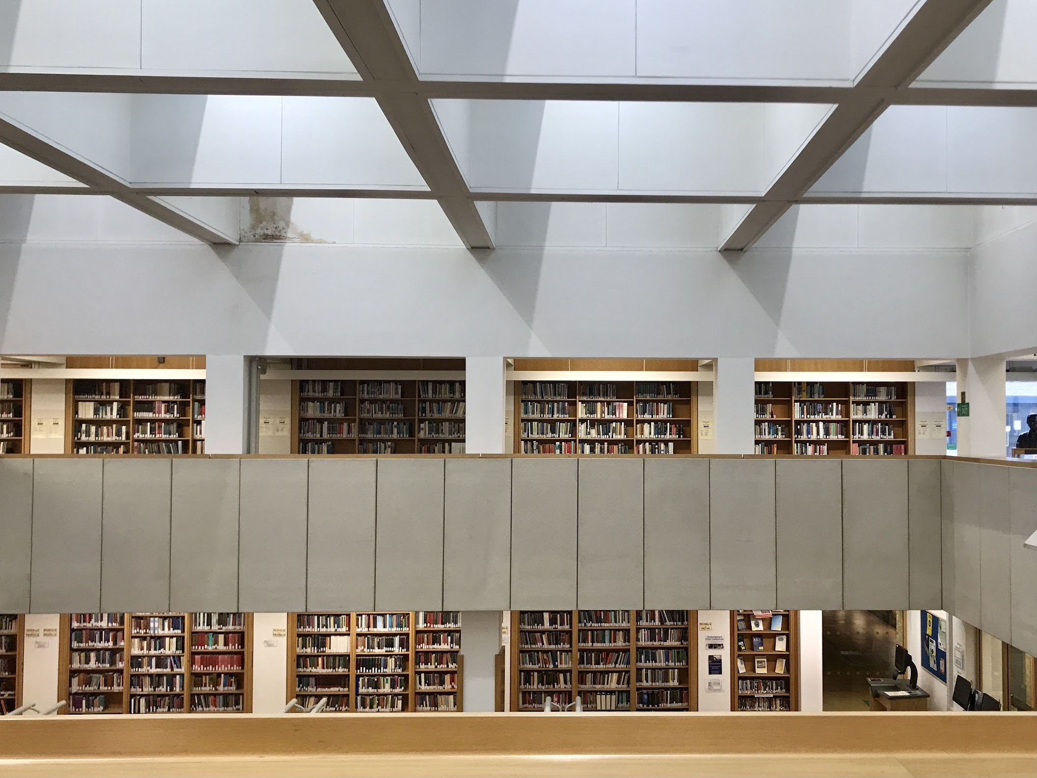 A photo taken from the top floor of the English Faculty Library, showing bookshelves.