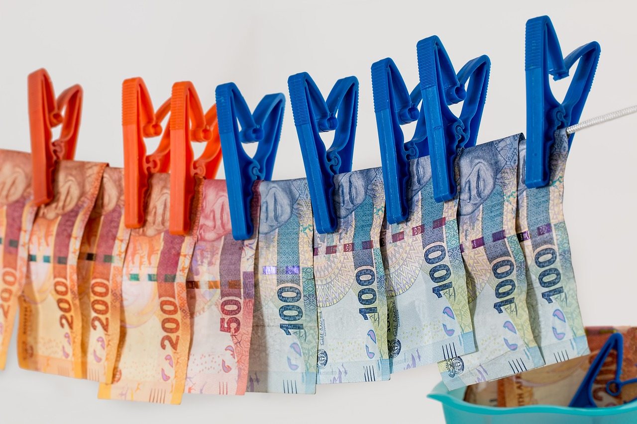 Money hanging out to dry on a drying line